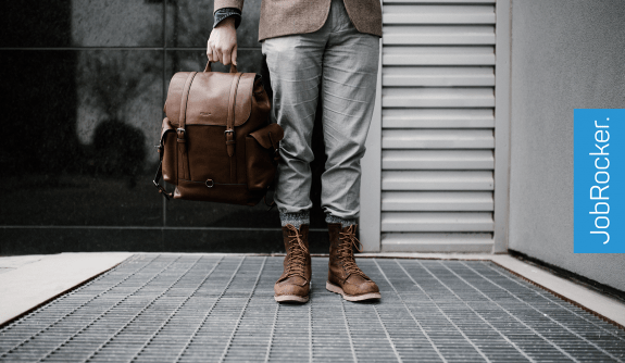 business casual outfit man boots handbag